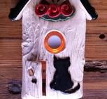 Ringklocka-Katt och röda blommor